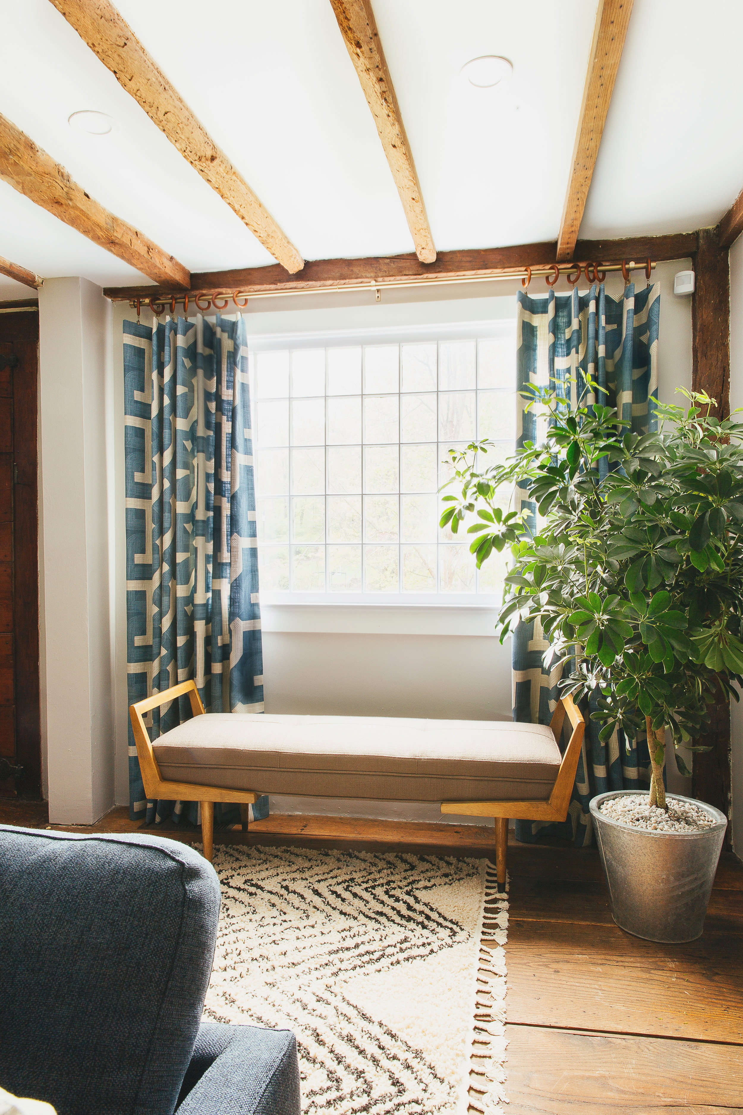 custom retro curtain panels and mid mod bench in farmhouse living room designed by The Rath Project