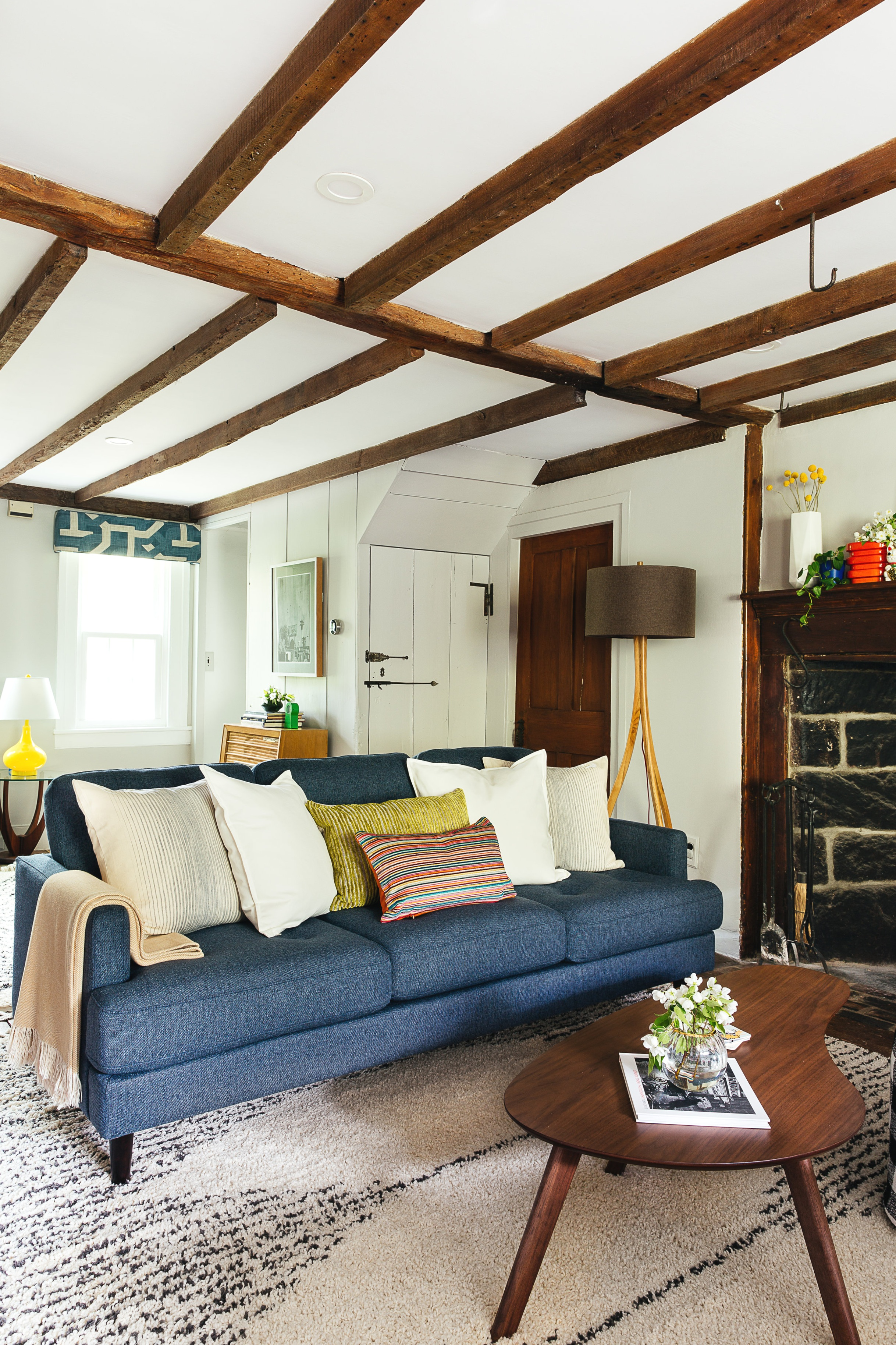 Antique+farmhouse+turned+mid+mod+living+room+design+with+fireplace+by+the+rath+project