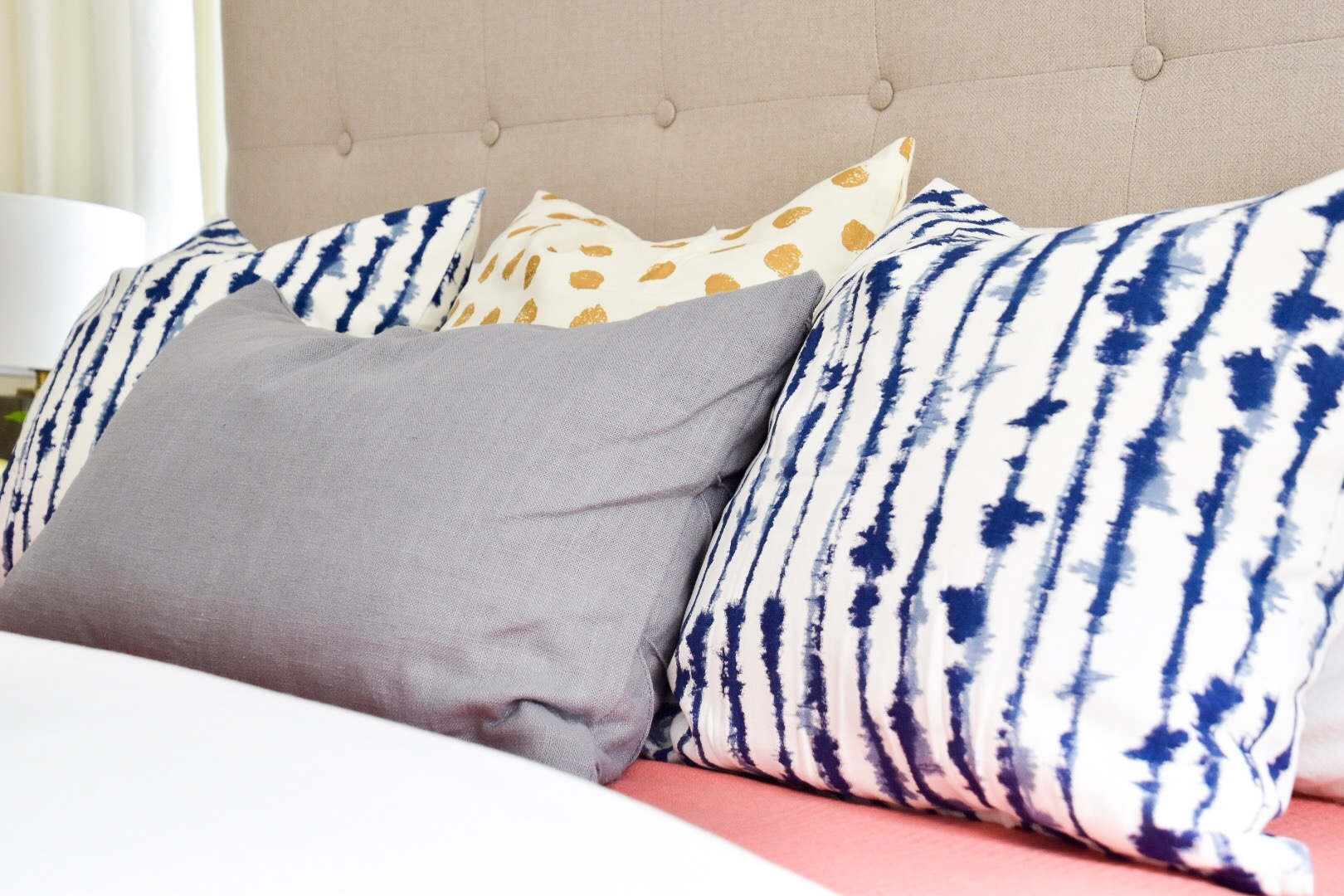 Bedding and accent pillows styled for Habitat for Humanity house
