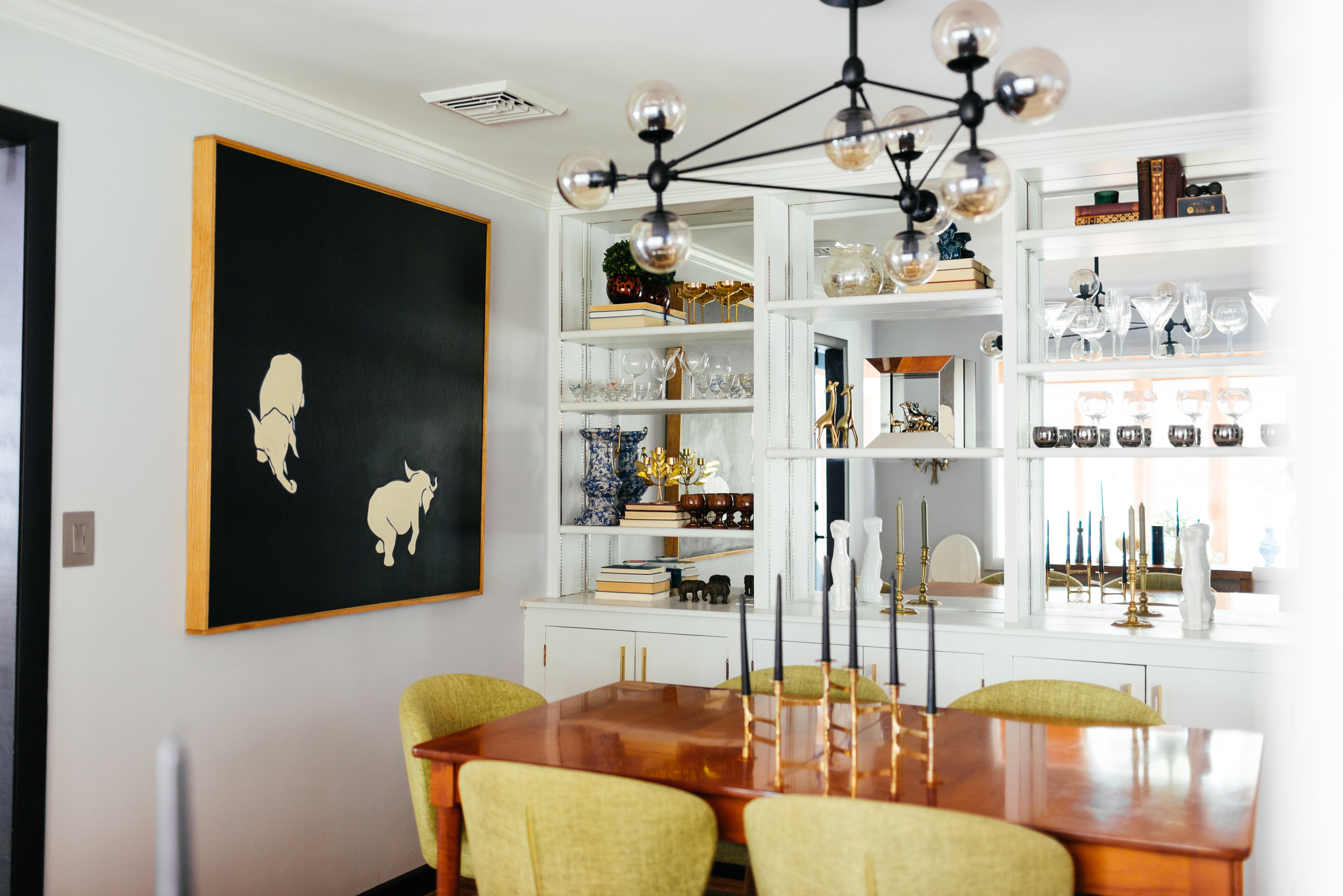 dining room with mirrored built ins and modern light fixture by the rath project