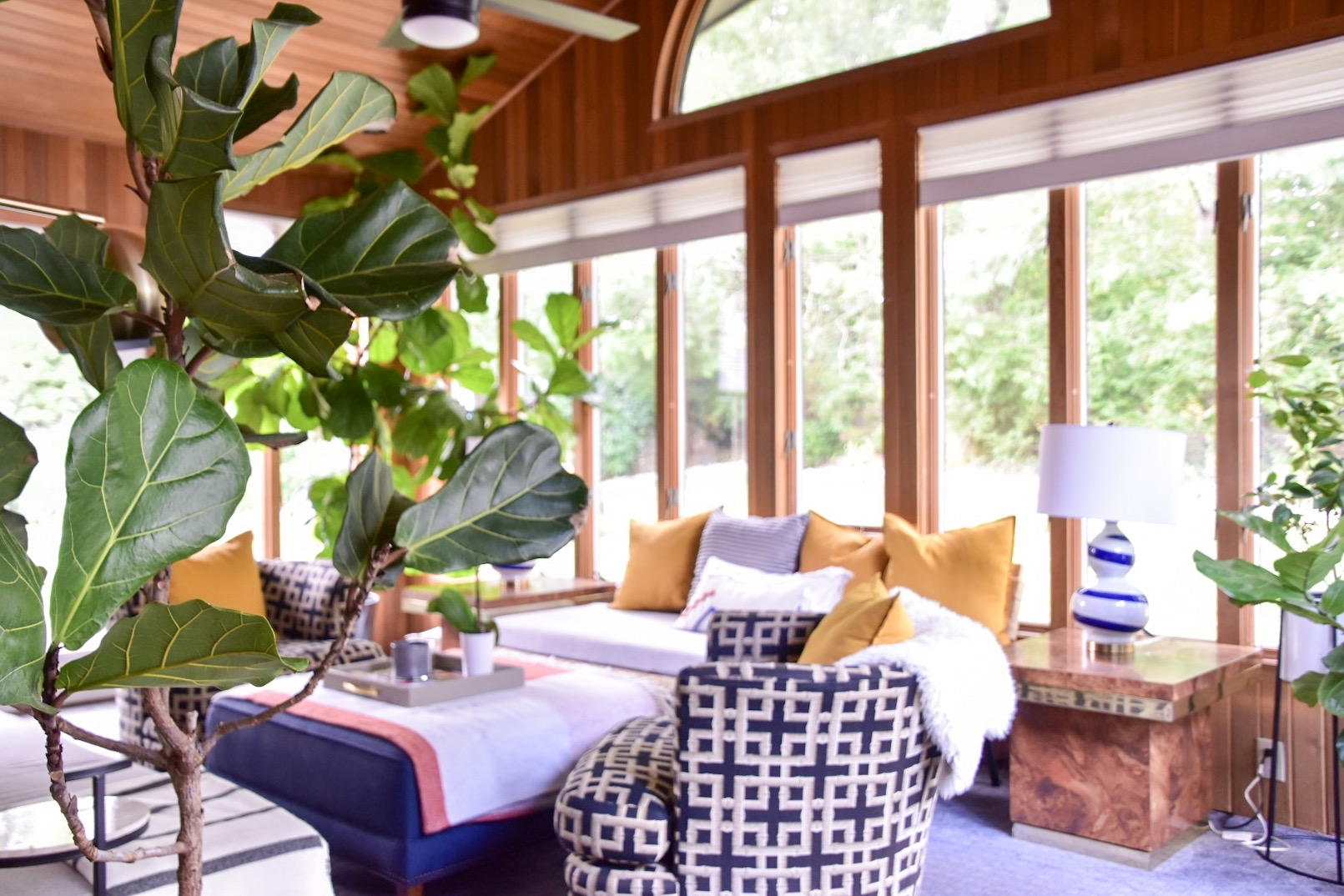 mid century inspired wood paneled sunroom by the rath project
