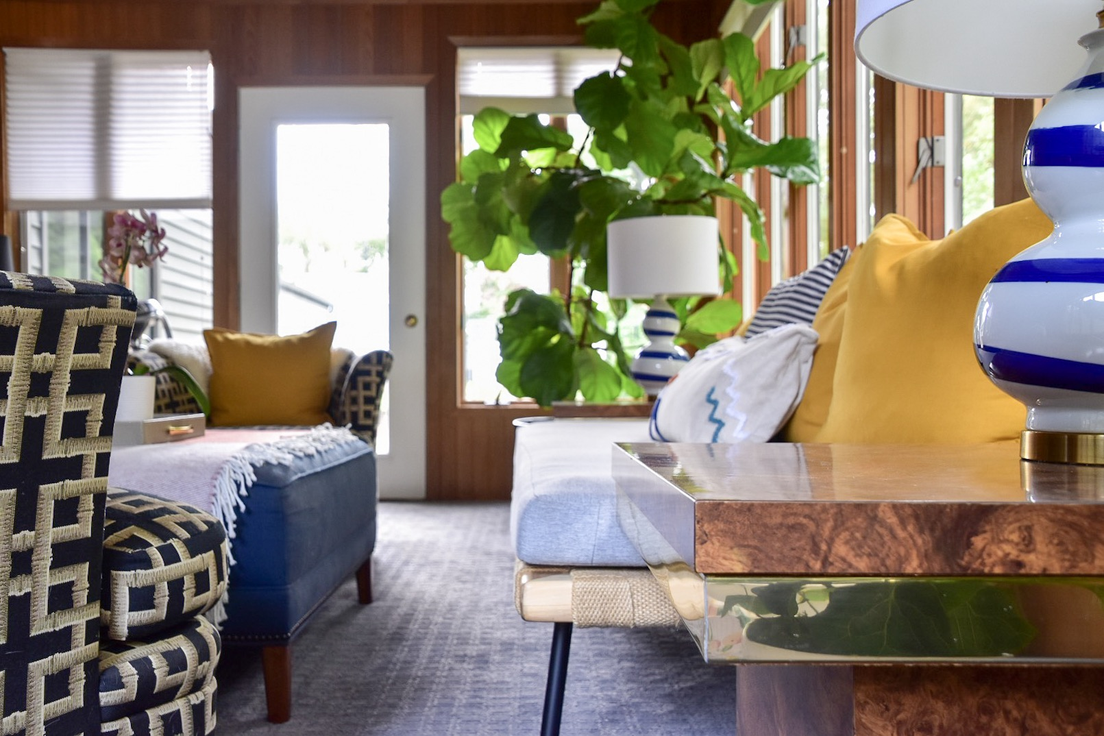 mid century inspired sunroom with giant fiddle leaf fig by the rath project