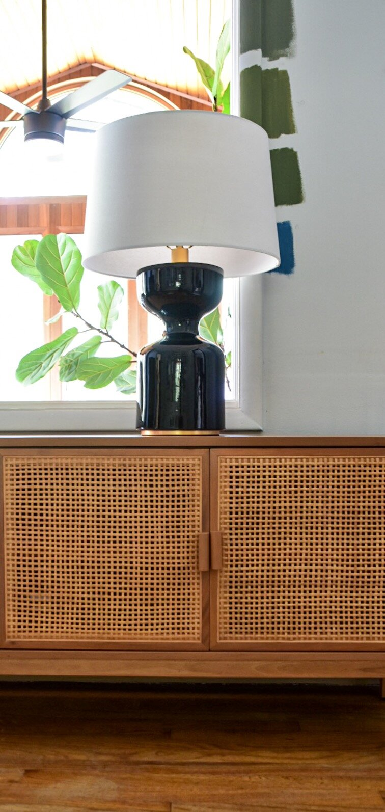black table lamp on cane console the rath project