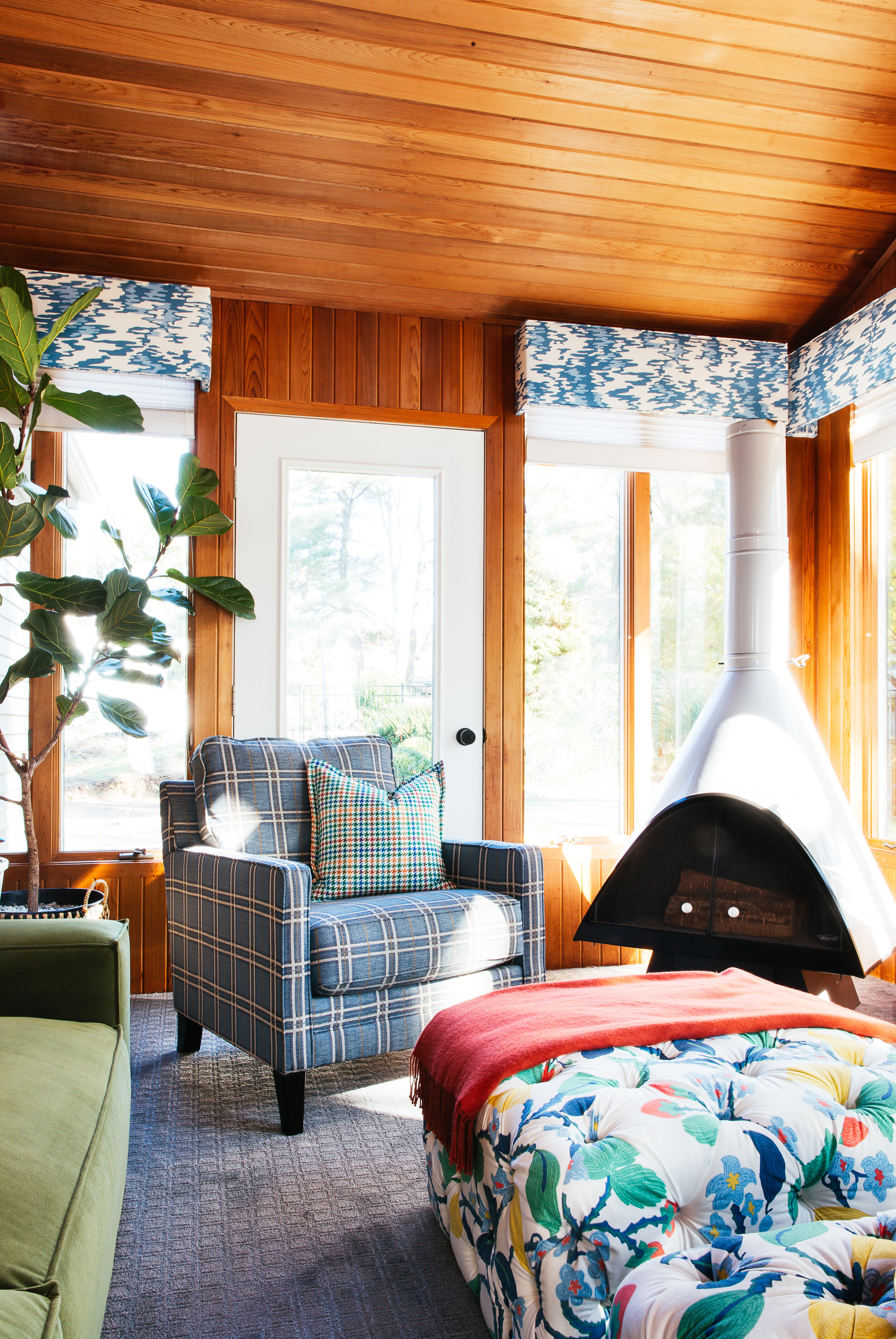 ORC sunroom fireplace and plaid chair Raymour and Flanigan modern mid century design by TheRathProject.jpg