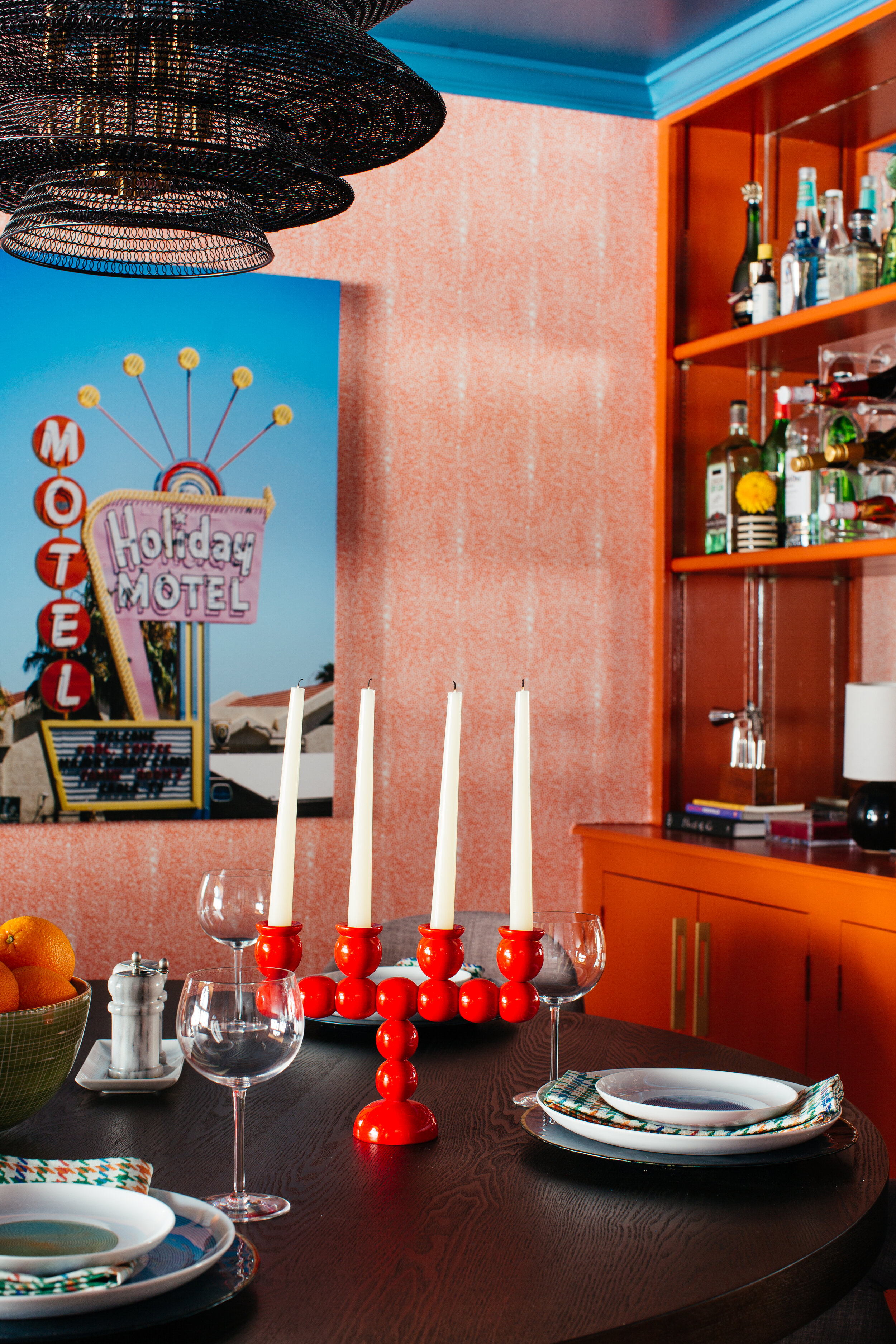 ORC design by TheRathProjectdining room table red swedish candelabra from Chairsihand motel art from chairish and minted.jpg