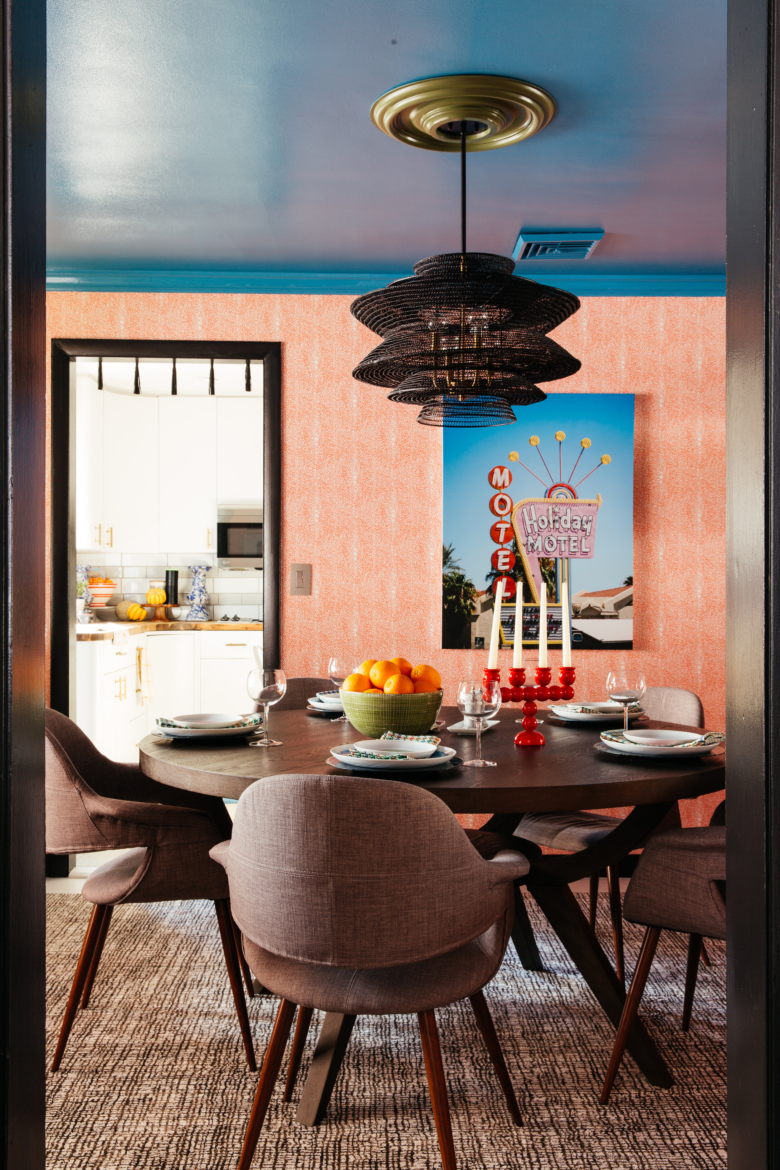 ORC dining room into kitchen from living room with sarinen style chairs lamps plus and motel art by minted design by TheRathProject.jpg