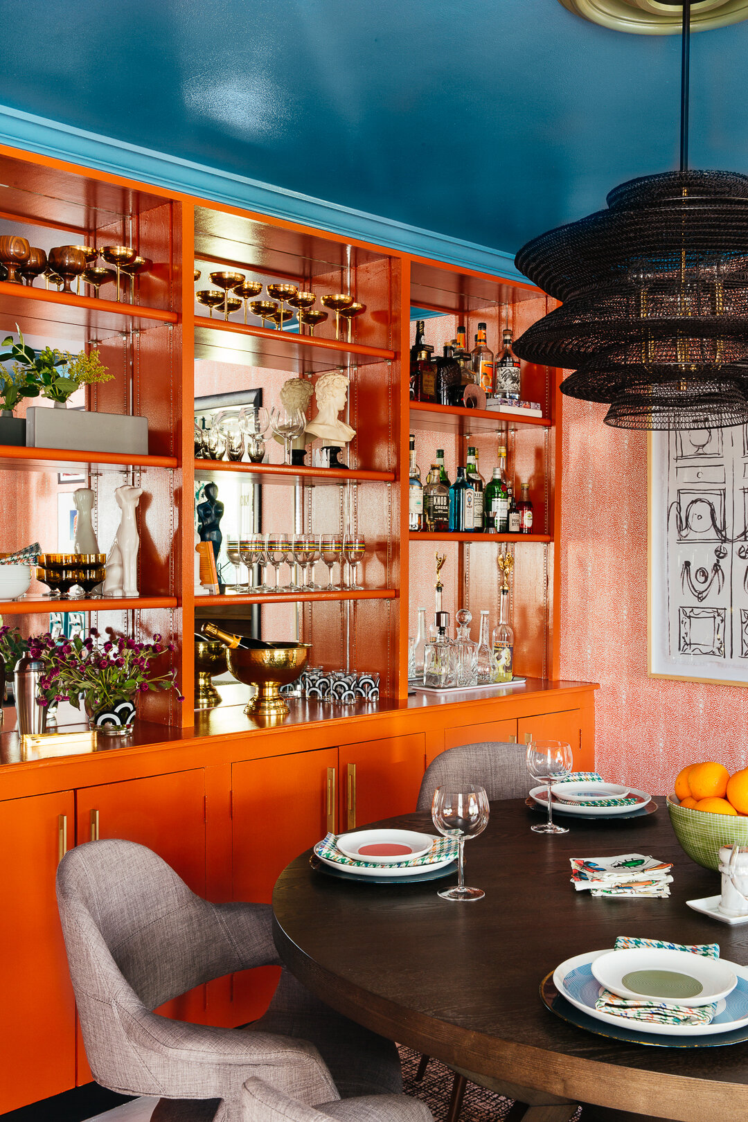 sm ORC dining room chandelier closeup with orange built ins by TheRathProject.jpg
