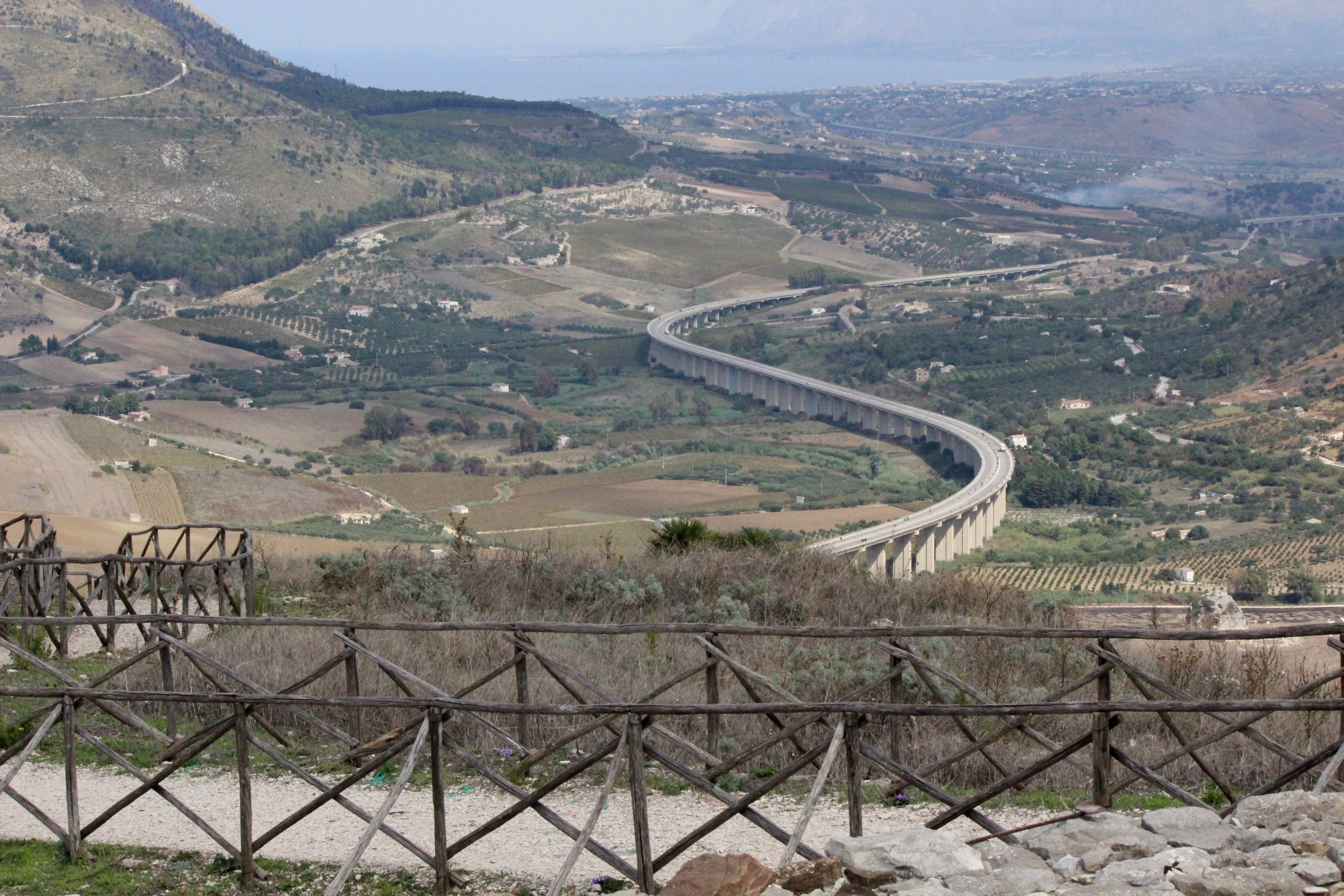 From the site, looking out at the snaking freeway that is headed toward the Tyrrhenian Sea in the distance.