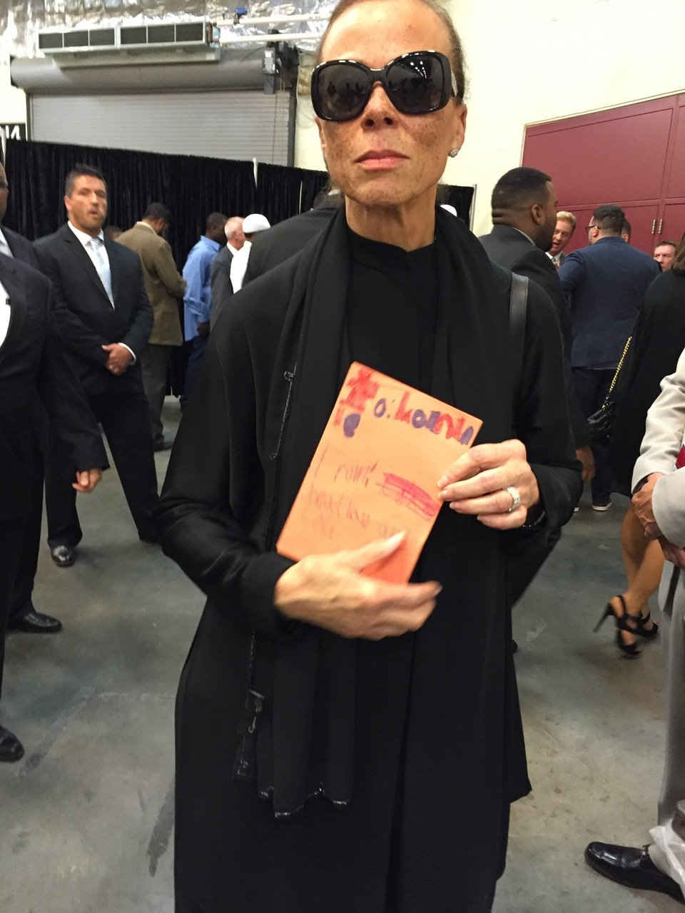 Lonnie Ali holding the card Lola made for her.
