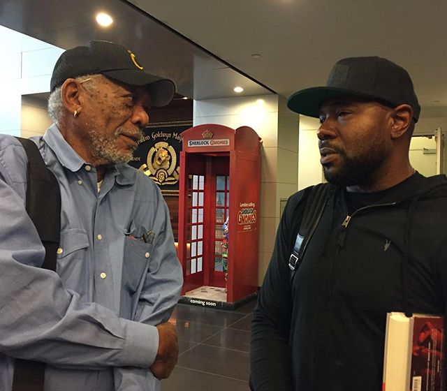 Morgan Freeman and Antoine Fuqua talking about the Ali book tucked under Antoine's arm!