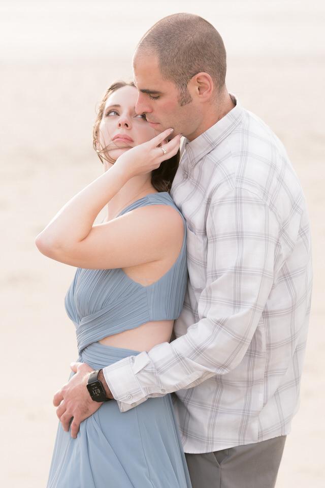Couple on the beach poses romantic