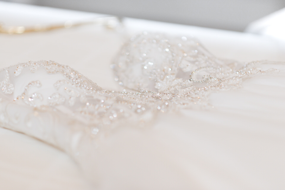 beaded and crystal wedding gown with tulle winter wedding Seattle.jpg