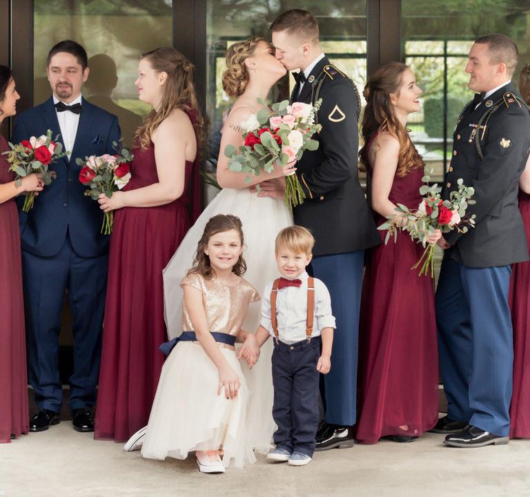 bridesmaids and groomsmen bride groom kissing portraits Seattle cservinphotographs.jpg
