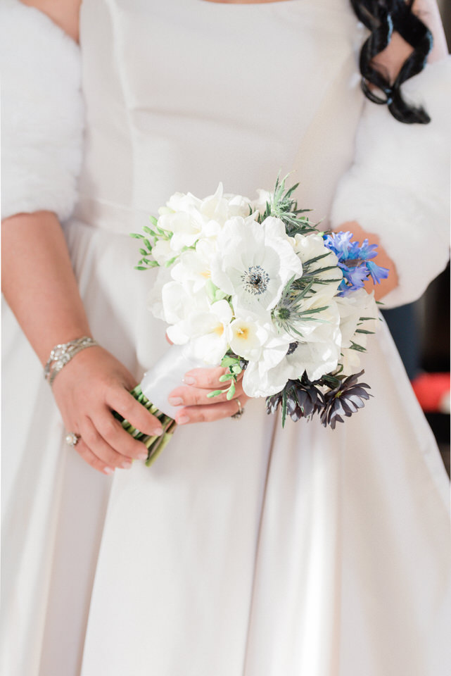 Bride holding white floral bouquet CServinPhotographs Seattle wedding-1.jpg
