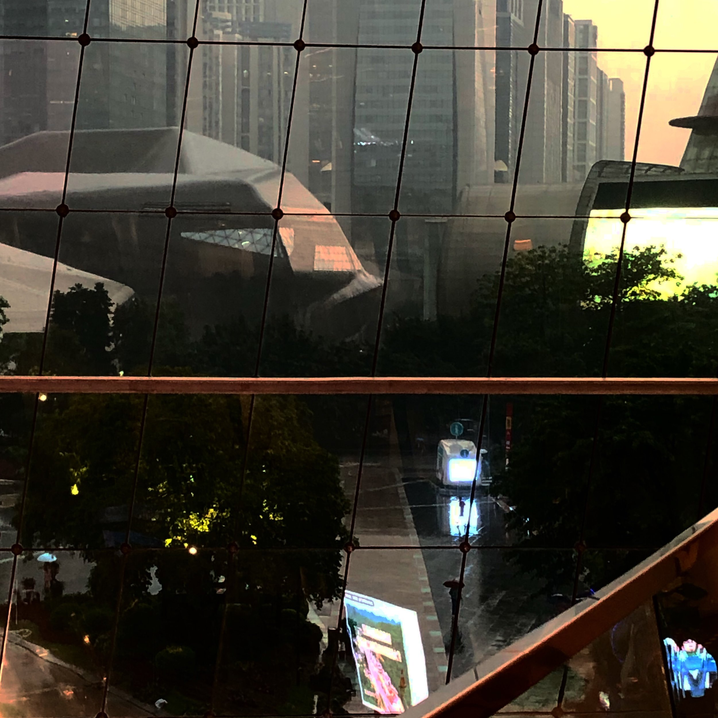 View of Zaha Hadid's Opera House (on the left) and its backdrop from the 3rd floor of the Guangzhou Library in Zhujiang New Town — a newly developed area in Guangzhou, China.