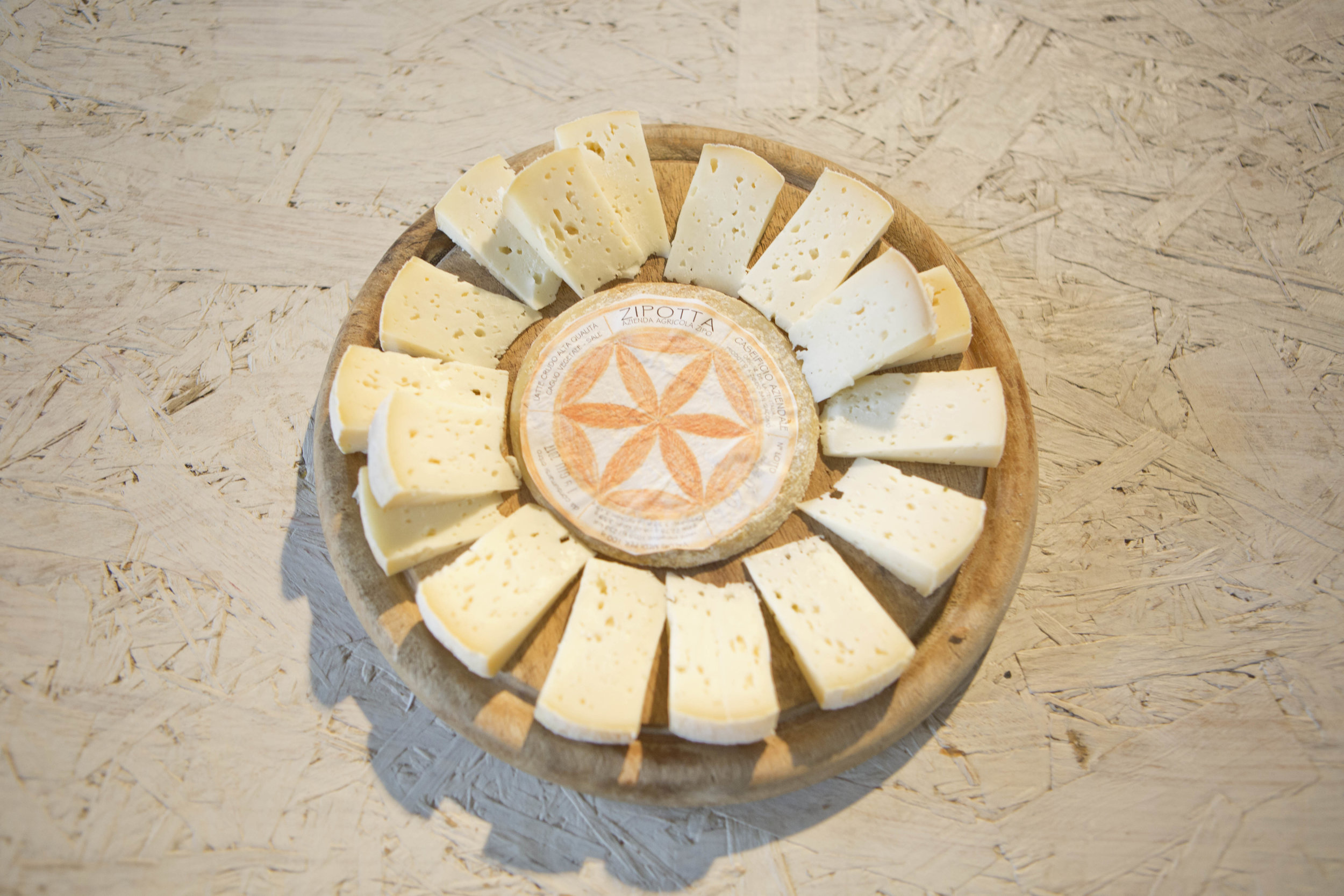 Zipo - Doing Italy - cheese cut into pieces.JPG