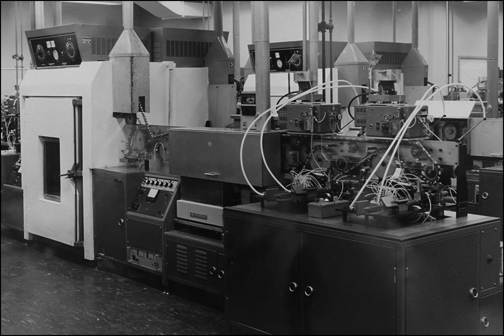 """One of Imperial's early """"Die Capping"""" machines, used to make integrated circuits for IBM. Circa 1960s."""