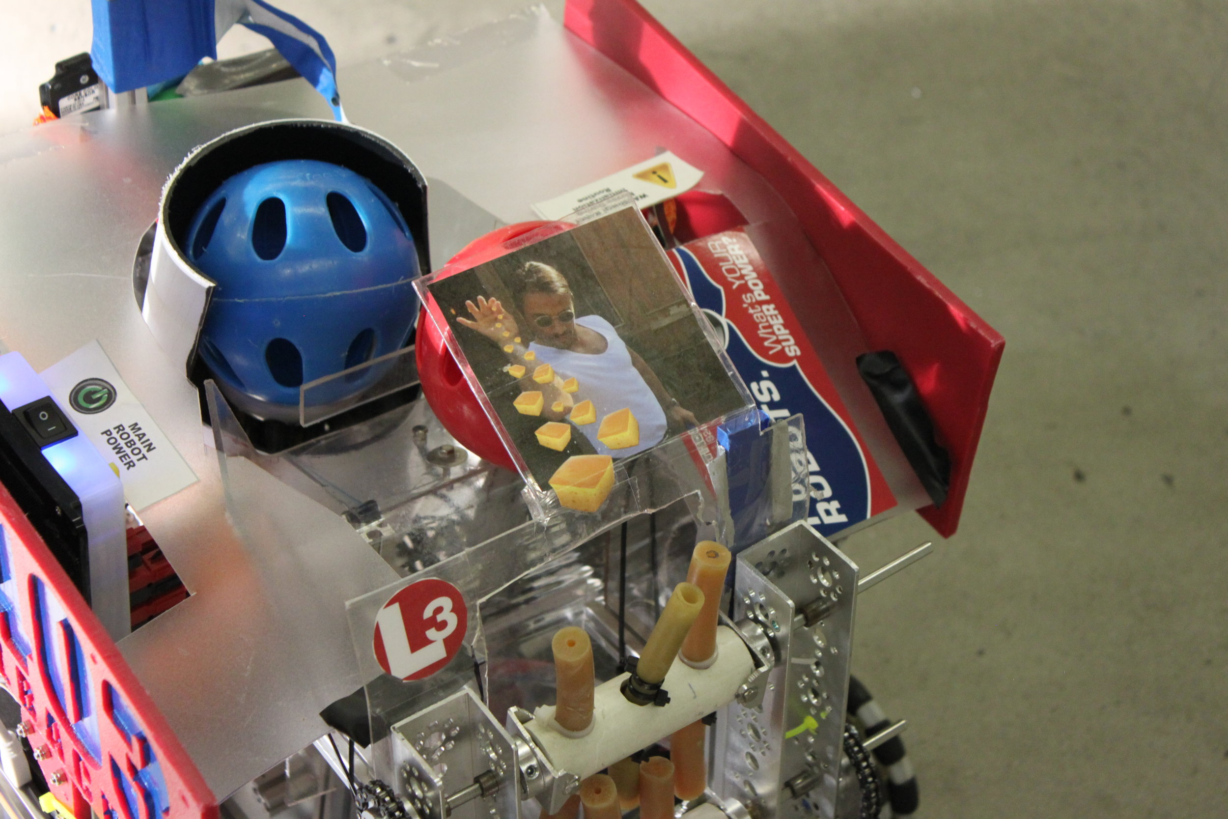 """We asked about the picture on their machine;the students said """"That's what gives our robot a little something extra."""""""