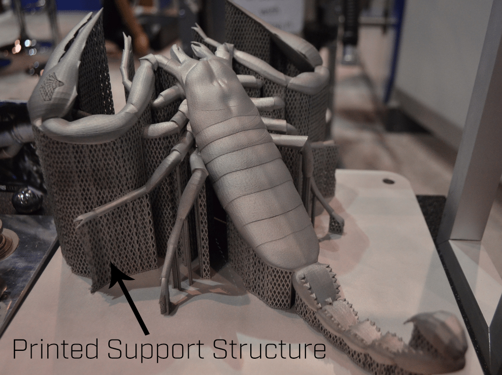 "This Scorpion build is a nice visual example of printed support structure. Without support, this build would have failed. After the build is completed the support structure is removed, leaving the original design. ""Thank you"" to the folks at  3D Printing Industry  for sharing this picture with us."