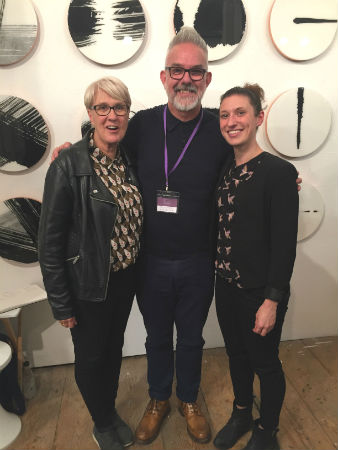 Carol and Amy Catching Up with their Artist Rod McIntosh