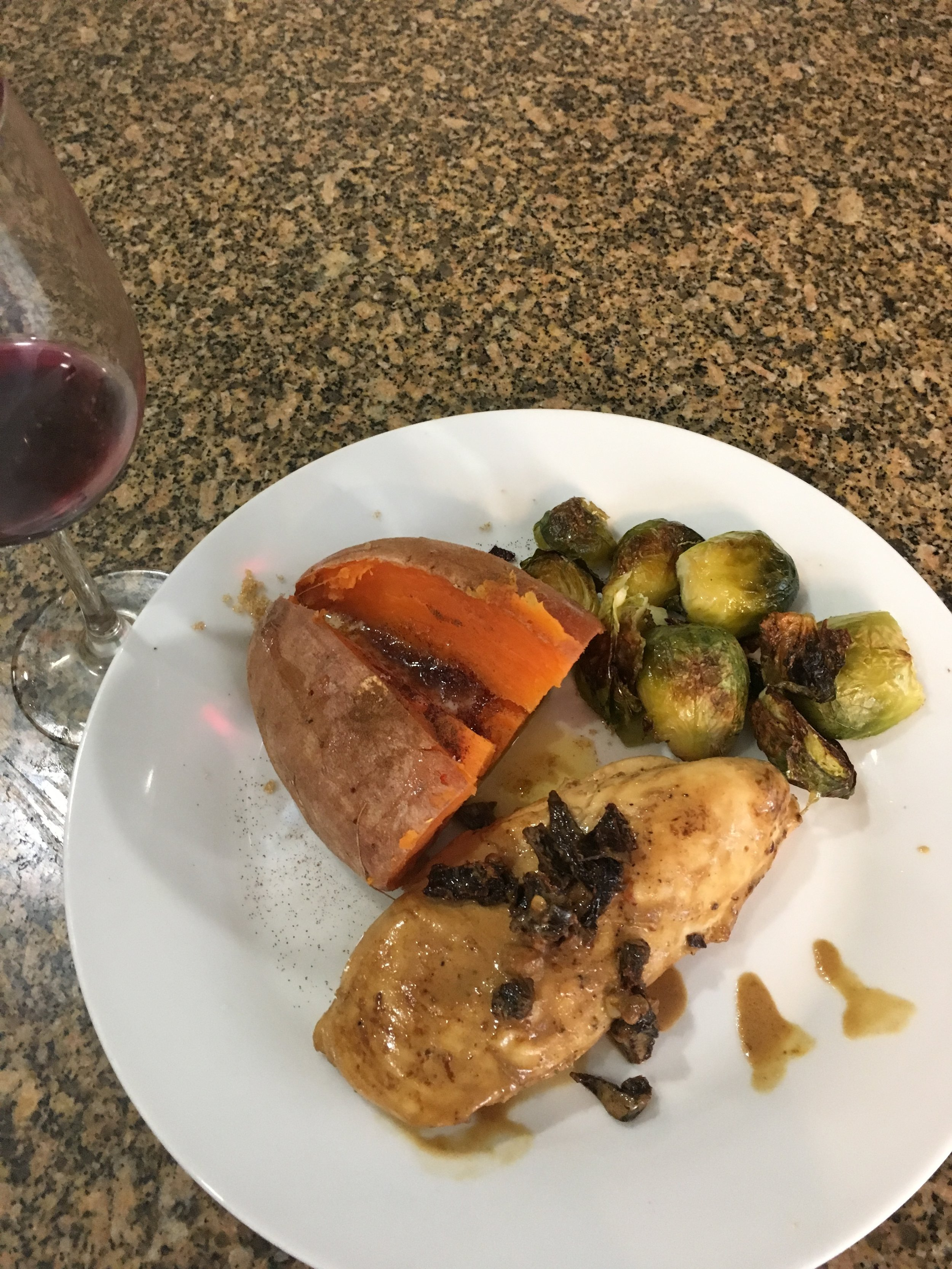 Tonights meal. Sundried tomato chicken, parmesan brussel sprouts and sweet potatoes.
