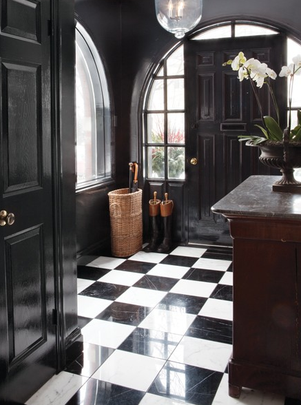 The inspiration...gloss black paint on the walls, doors and trim, along with black and white marble tiles creates extra drama in this super classy entryway. Image via This Ivy House