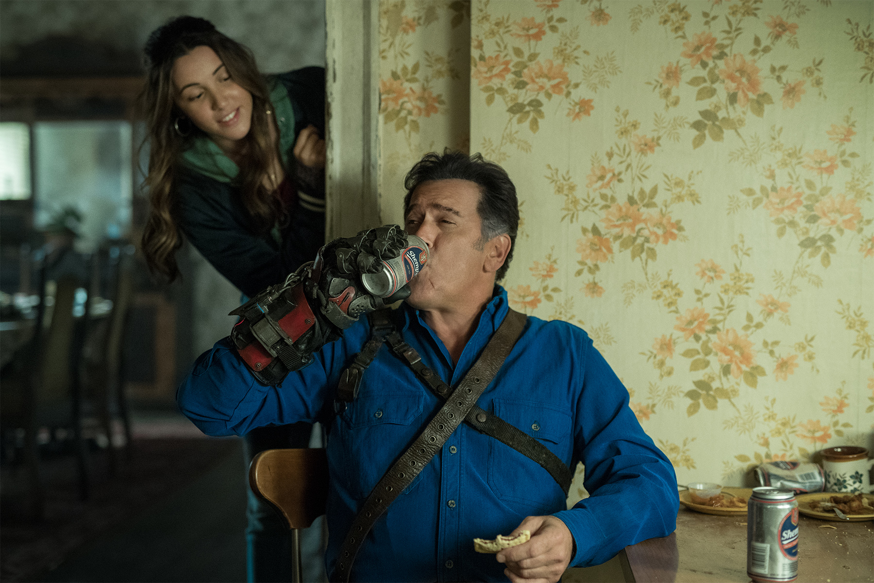 S03 E06 Bruce Campbell and Arielle Carver-O'Neill.jpg