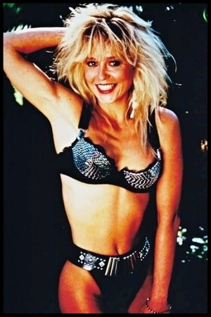 Linnea Quigley  has to be in the running for the title of Greatest Cult Movie Scream Queen.