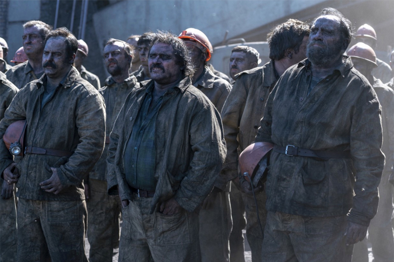 Alex Ferns and miners in Chernobyl