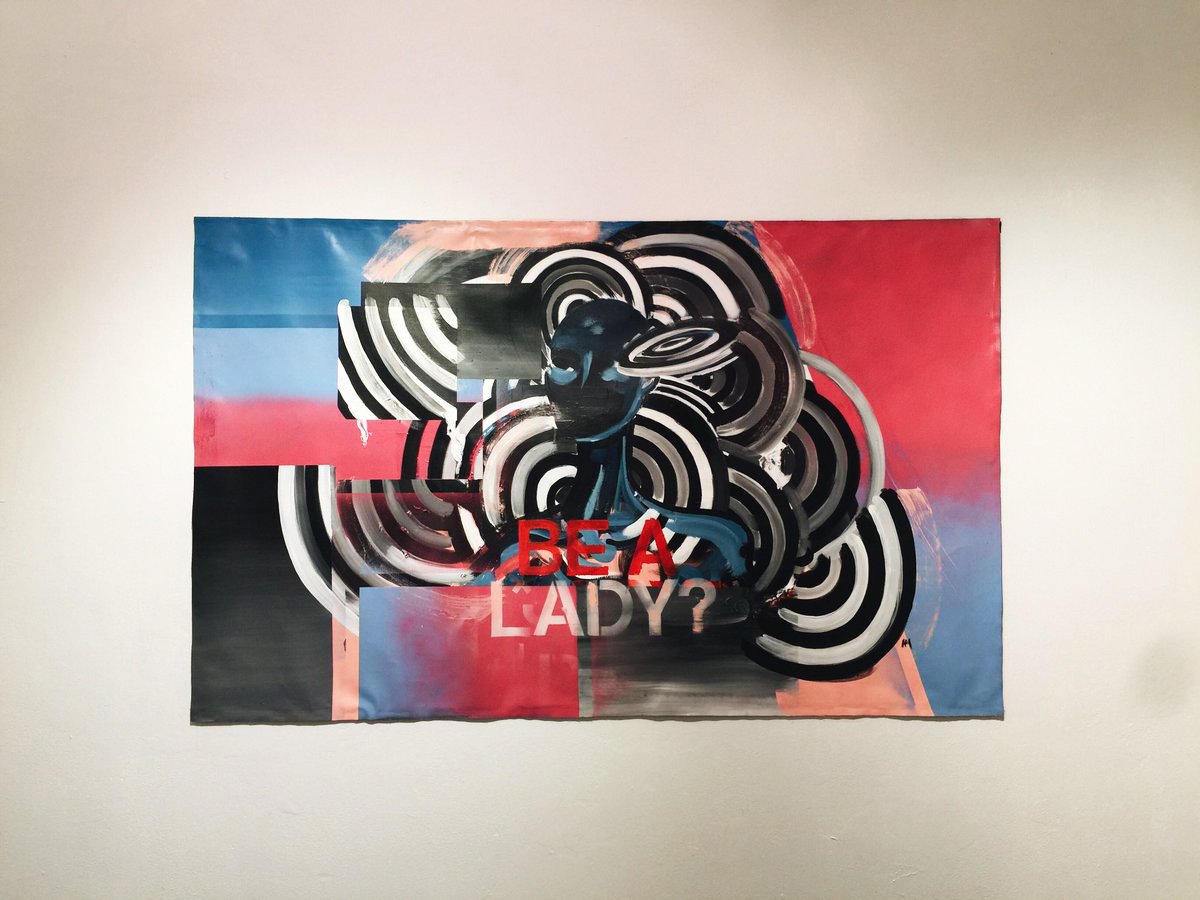 """Anti-Pro Exhibition       The piece """"Be a Lady?"""" deals with the information that many young girls receive while growing up. We are often taught that to be a lady means to only operate under a set of rules that are deemed feminine and appropriate. The concentric circles , gradients and shifts of space represent the duality of masculine and feminine energy that exists, yet when unable to be expressed causes us to become stuck and trapped within this narrow way of thinking. From this stagnation the figure becomes void of any emotion or personality becoming manikin like, without freedom to express."""