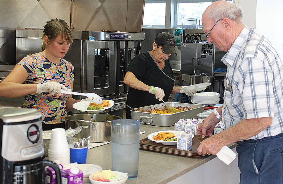 Food Service Workers Alaina Nelson and Elaine Ames serve up helpings of chicken fajitas for Gouverneur seniors citizens during the grand opening of the Gouverneur Congregate Dining Center at the Gouverneur Community Center on Oct. 23. Pictured is Winston Bishop of Gouverneur in line to receive the scrumptious meal. He was joined by wife Joanne (not pictured). The couple enjoyed the company of other Gouverneur-area senior citizens, renewing old friendships and making new ones. (Rachel Hunter photo)