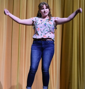 "Sydney Gale, second place winner of the 2018 Dean Oritoricals, gives her funny rendition of ""Dark Chocolate"" which she claims gives her the best fitness results. (photo by Jessyca Cardinell)"