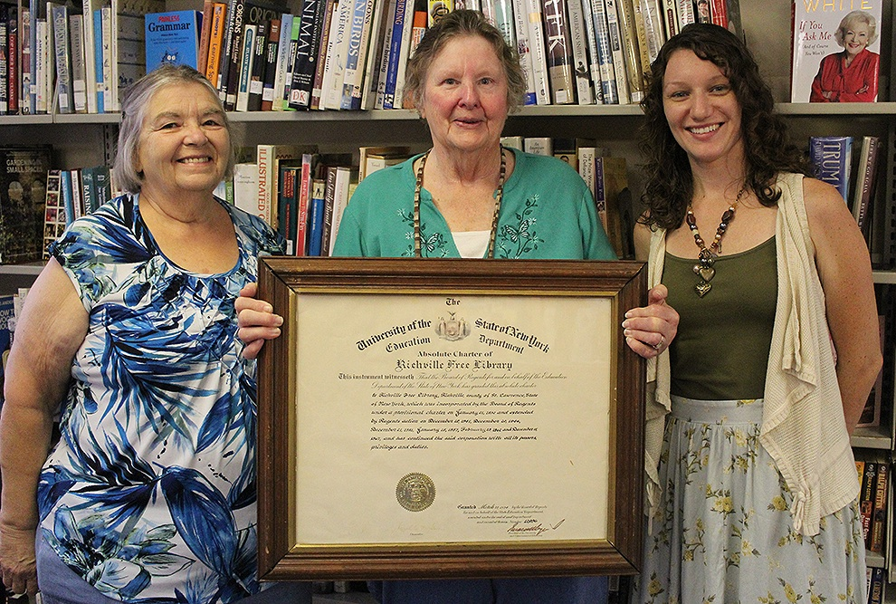 Pictured above with the charter of the Richville Free Library is (from left) Brenda Woodward, President of the Richville Library Board of Trustees, Lila Youngs, retiring Richville Library Director after 26 years of dedicated service, and Britny Harmer, incoming Richville Library Director. (Rachel Hunter photo)