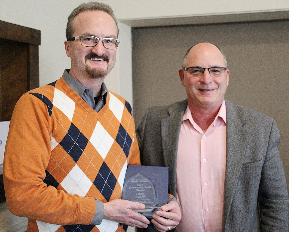 St. Lawrence NYSARC Executive Director Howie Ganter presenting the 2018 Community Spirit Award to Casey Canell of Gouverneur on October 18. (Rachel Hunter photo)