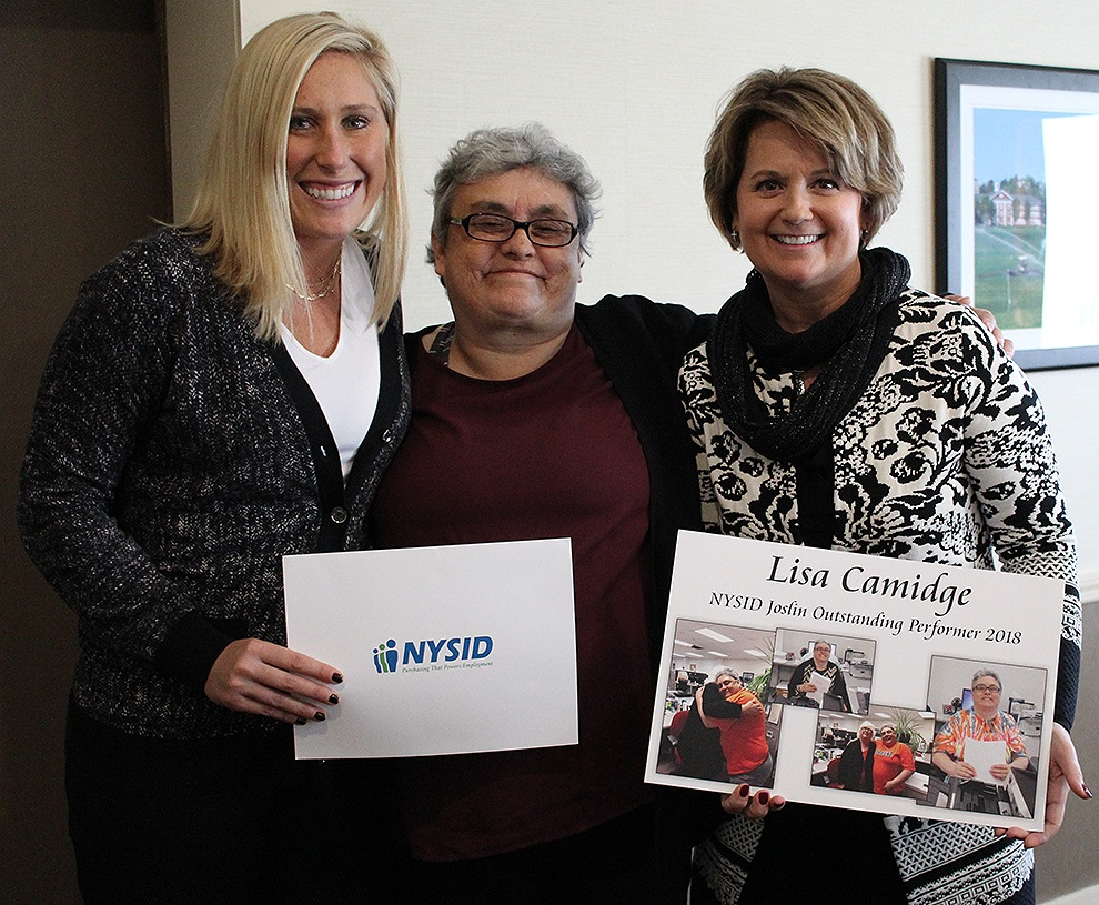 New York State Industries for the Disabled, Inc. (NYSID) Central New York Representative Katie Tucci (at left) presenting Lisa Camidge of DeKalb (center) with the 2018 Outstanding Performer Award. St. Lawrence NYSARC Director of Contracts and Business Development Tracy Hutton (at right) presents Lisa with a special photo collage memento. (Rachel Hunter photo)