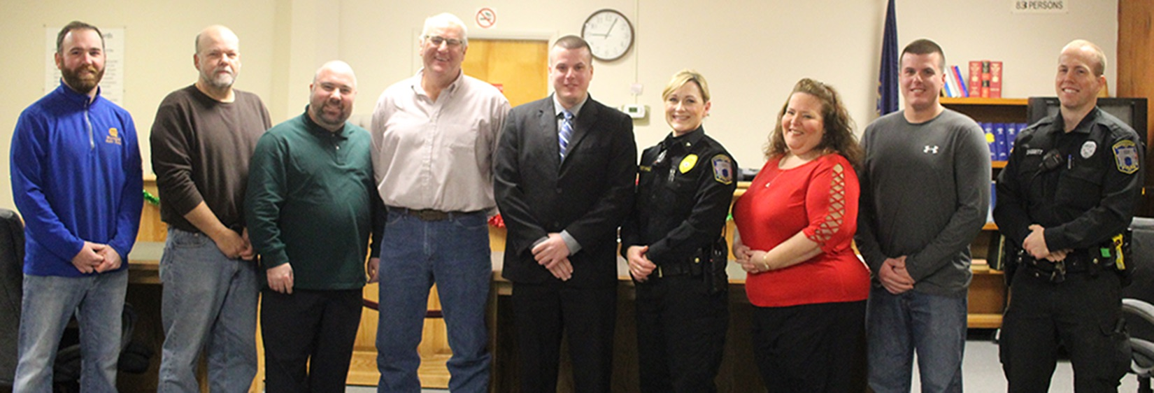 Gouverneur Police Department's newest officer, Nathan B. Sheen of Gouverneur, with supporters during his official swearing-in ceremony on Wednesday, January 2 in the municipal courtroom. From left: Village of Gouverneur Deputy Mayor Charles Newvine, Village of Gouverneur Trustee Rick Wood, Village of Gouverneur Trustee Troy Besaw, Jeff Sheen (Nathan's father), Nathan B. Sheen, Village of Gouverneur Chief of Police Laurina Greenhill, Village of Gouverneur Clerk/Treasurer Barbara Finnie, Gouverneur Police Officer Jesse Sheen (Nathan's twin brother), and Gouverneur Police Department Ptl. Alexander Daggett. (Rachel Hunter photo)