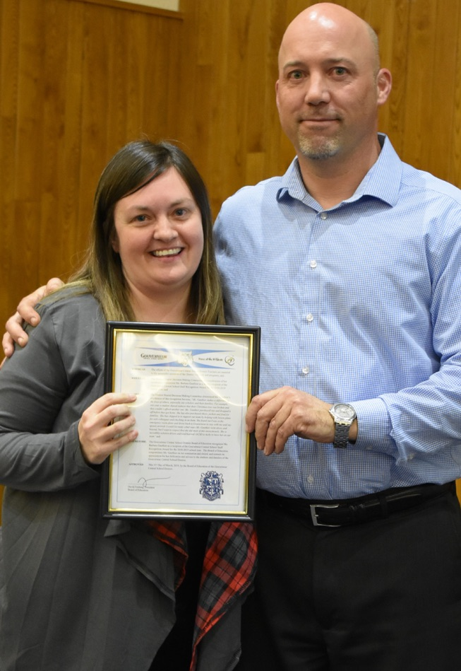 Barbara Gauthier (left) proudly holds her Staff Recognition Award received for her dedication to the Gouverneur School District. GCS Board of Education President David Fenlong (right) helps in this recognition. (photo by Jessyca Cardinell)