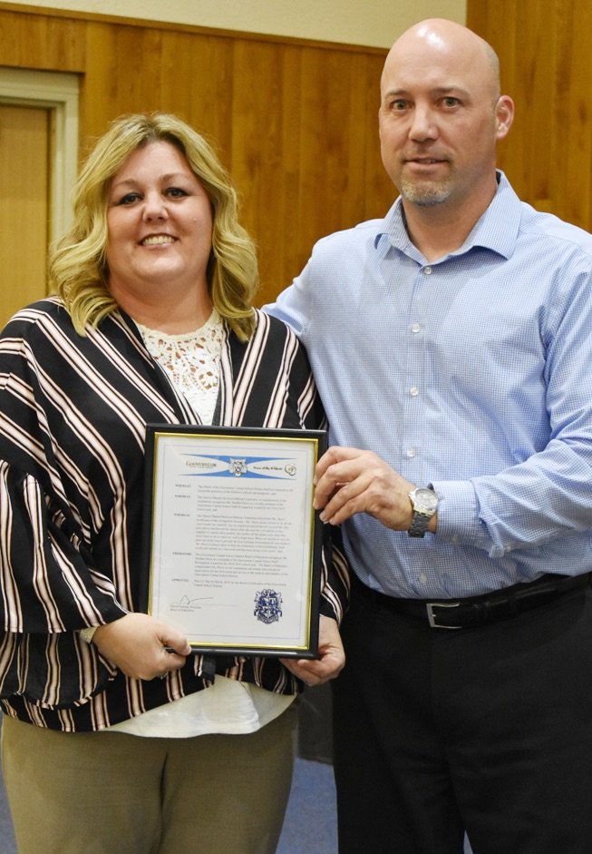 Heather Davis (left) honored for going above and beyond as a recipient of a GCS Staff Recognition Award. GCS Board of Education President David Fenlong (right) proudly helps in this recognition. (photo by Jessyca Cardinell)