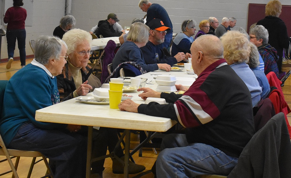 Attendees of the first St. James fish fry of the season enjoy a delicious dinner and each other's fellowship. (photo by Jessyca Cardinell)