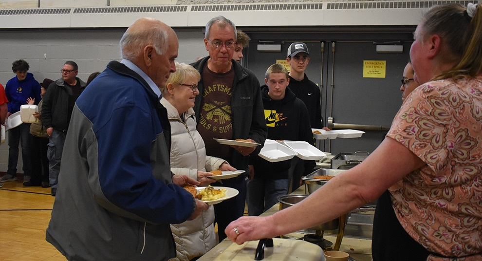 The first St. James fish fry dinner of the season drew a great number of people. A long line went through the gymnasium in anticipation of getting their delicious meal. (photo by Jessyca Cardinell)