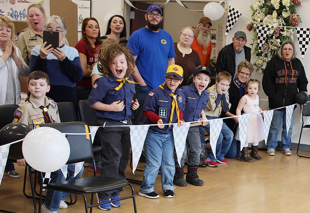 Cub scouts show their enthusiasm as the derby cars cross the finish line during the first-ever Gouverneur Cub Scout Pack 2035 Pinewood Derby on Saturday, March 30 in the Gouverneur Community Center. (Rachel Hunter photo)