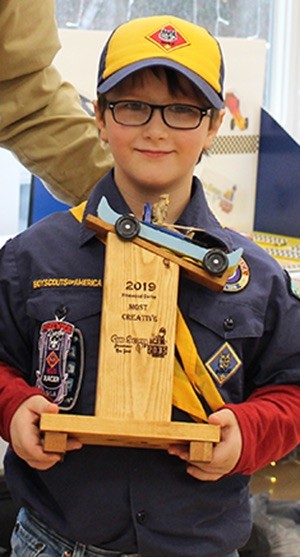 Carter McGill won the Most Creative trophy for turning his pinewood derby car into a pinewood derby boat! Carter McGill is pictured (at right) with Cubmaster Chris Gates (at left). (Rachel Hunter photo)
