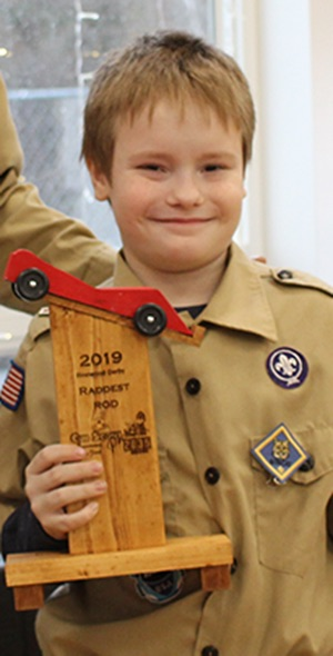 Qhuin Langille won the Raddest Rod trophy for his red pinewood derby car. Qhuin is pictured (at right) with Cubmaster Chris Gates (at left). (Rachel Hunter photo)
