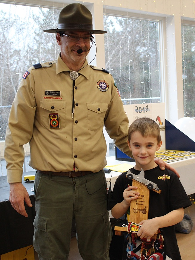 Nathan Zeller won the Slowest Roller trophy for his shark-themed pinewood derby car. Nathan Zeller is pictured (at right) with Cubmaster Chris Gates (at left). (Rachel Hunter photo)