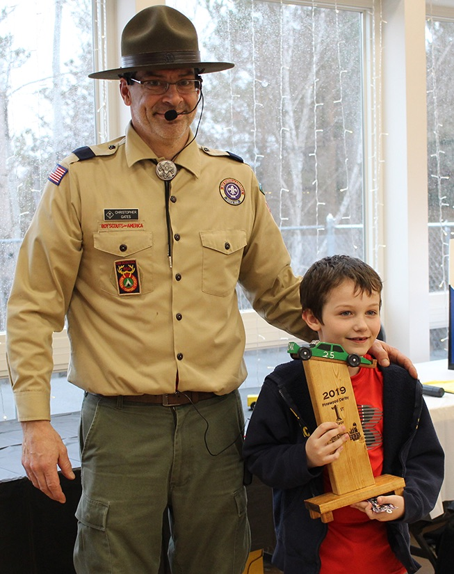 Jax Spicer won the First Place trophy for the fastest derby car. Jax Spicer is pictured (at right) with Cubmaster Chris Gates (at left). (Rachel Hunter photo)