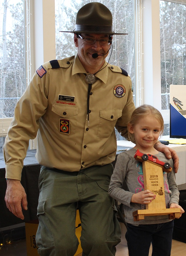 Aubree Spicer (at right) won the Scouts Choice trophy, presented by Cubmaster Chris Gates (at left). (Rachel Hunter photo)