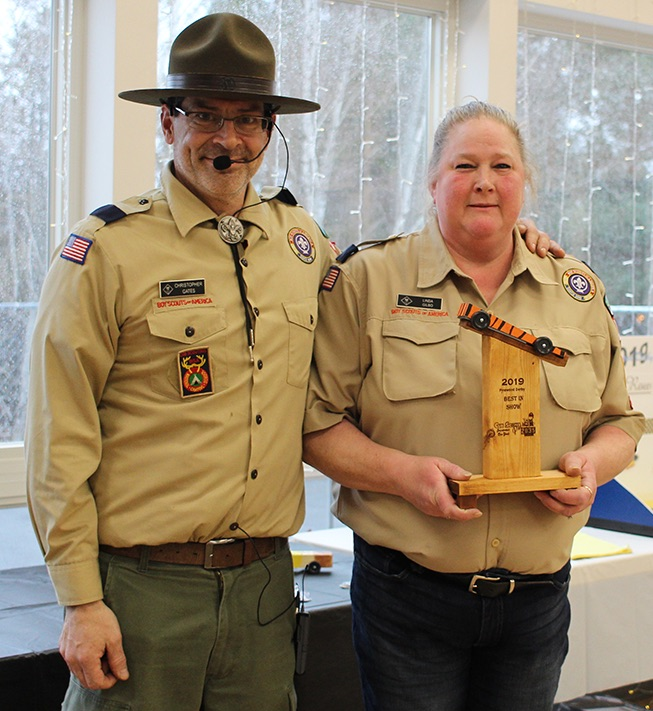 Cub Scout Pack 2035 Committee Member Linda Gilbo of Richville (at right) won the Best In Show trophy, presented by Cubmaster Chris Gates (at left). (Rachel Hunter photo)