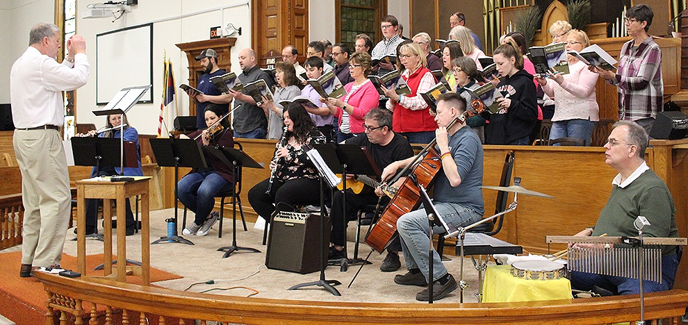"The Gouverneur Community Chorus and instrumentalists, under the direction of Dr. Donald Schuessler, Jr., preparing to present ""The Song Everlasting,"" written and arranged by Joseph Martin, at the First United Methodist Church of Gouverneur, 34 Grove St., on Sunday, April 14, 4 p.m. (Rachel Hunter photo)"