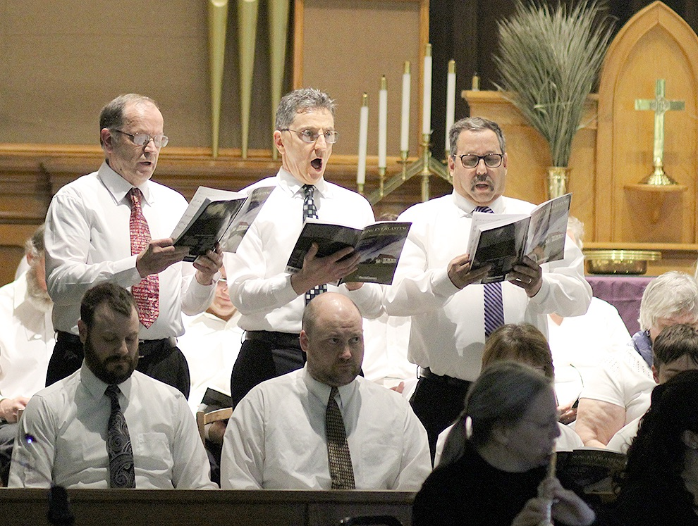Gouverneur Community Chorus members Harry Smithers, Sid Peters, and Blane Shrewsberry singing during the cantata. (Rachel Hunter photo)
