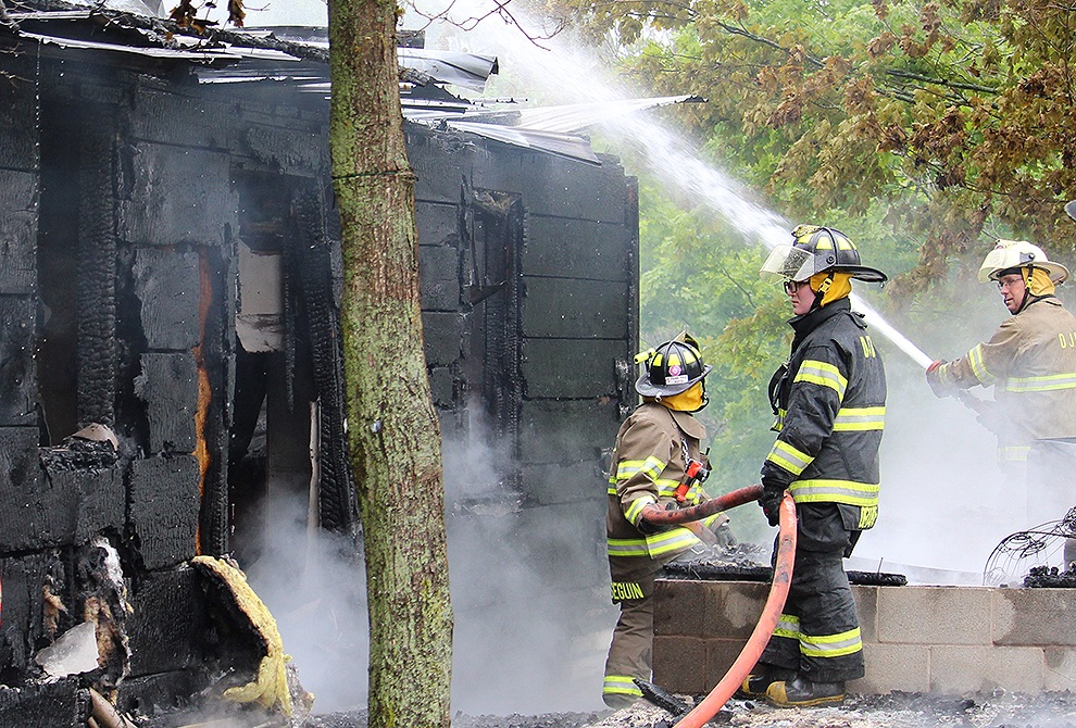DeKalb Junction firefighters work to douse the structure pictured following the fiery blaze.